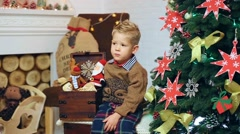 Adorable blond boy in festively decorated home interior. - stock footage