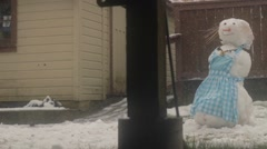 Snowman in the back yard Stock Footage