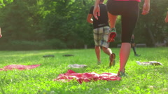 Panning shot of people excercising in the park - stock footage