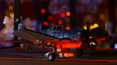 Toy plane is on the shelf amid flashing colored lights Stock Footage