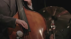 A double bassist and drummer playing jazz Stock Footage
