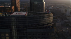 Close flight past Wells Fargo building and others with Los Angeles cityscape Stock Footage