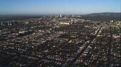 Flying over residential area, Santa Monica in distance. Shot in 2010. - stock footage