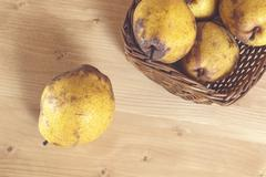 Fresh organic pears on old wood. Pear autumn harvest. - stock photo