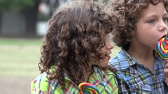 Brothers Eating Lollipop Candy Stock Footage