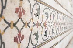 Decorative elements of Taj Mahal created by applying paint, stucco, stone inl - stock photo