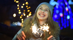 Young girl with a sparkler - stock footage