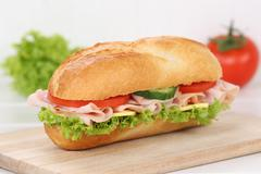 Sub deli sandwich baguette with ham for breakfast - stock photo
