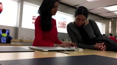 People buying computer and paying credit card inside Apple store Stock Footage