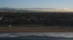 Beachfront south of Santa Monica, smog in distance. Shot in 2010. - stock footage