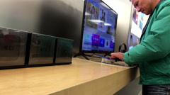 People playing new ipad inside Apple store - stock footage