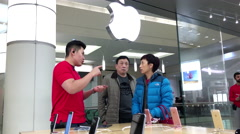 People buying iphone and paying credit card inside Apple store - stock footage