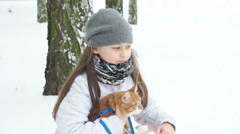 girl and a cat for a walk in the park - stock footage
