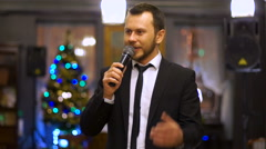 Young presenter speaks into the microphone at the festival Stock Footage