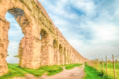 Defocused background with ruins of ancient Roman Aqueducts, Rome, Italy Stock Photos
