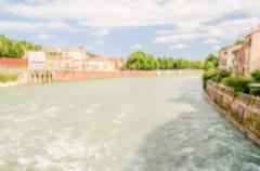 Defocused background with view over Adige River in Verona, Italy - stock photo