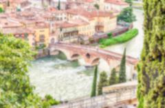 Defocused background with ancient stone bridge in Verona, Italy - stock photo