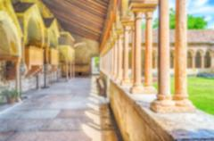 Defocused background with cloister of San Zeno Cathedral in Verona - stock photo