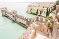 Defocused background, aerial view of Sirmione from the Castle, Italy - stock photo