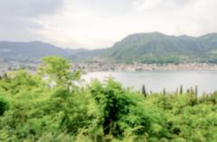 Defocused background with panoramic view over Salo town, Italy - stock photo