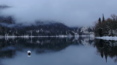 Alpine Lake Ritsa in winter under gloomy clouds, Abkhazia. Full HD Stock Footage