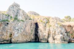 Defocused background with wild coastline of Zingaro Natural Reserve, Sicily - stock photo