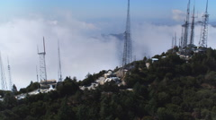 Flying past telecommunication towers at Mount Wilson Observatory, California. - stock footage