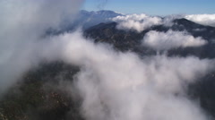 Flying through clouds over the Angeles National Forest in the rugged San Gabriel - stock footage