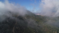 Flying over a misty ridge in Angeles National Forest in the San Gabriel Stock Footage