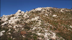 Over rocky mountaintops in the Angeles National Forest, California. Shot in Stock Footage
