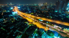 Modern city at night with traffic light timelapse, Bangkok Thailand Stock Footage