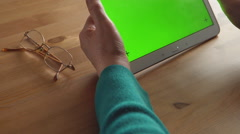 Stock Video Footage of iPad in a adult woman hands (green screen)
