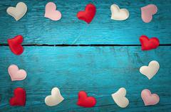 Red hearts on the blue boards Stock Photos