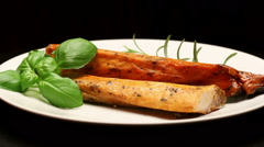 Smoked carp with aromatic herbs on white plate, rotating Stock Footage