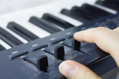 Synthesizer keyboard is very close - stock photo