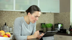 Young woman with tablet computer looking shocked HD - stock footage