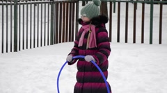 Winter Children sports program - boy and girl Running with rings - stock footage