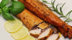 Smoked carp with aromatic herbs and lemon on white plate, rotating Stock Footage