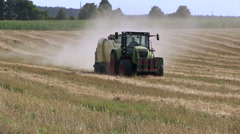 Straw baling round bales zoom out Stock Footage