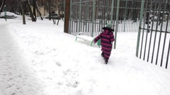 boy and girl playing snowballs in winter - stock footage