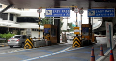 Traffic at Highway Toll Booth Stock Footage