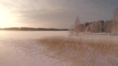 Winter landscape, evening sunlight, seaside ice 4K Stock Footage