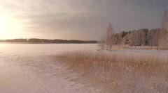Winter landscape, evening sunlight, seaside ice 4K Arkistovideo
