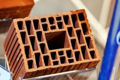 Orange hollow clay block - stock photo