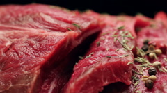 Fresh raw beef meat with peppercorns ready to grill, rotating - stock footage
