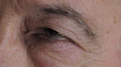 Closeup on the closed eyed of an adult man, white Stock Footage