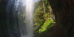 Wide angle view from behind a waterfall in Oregon's Silver Falls State Park Stock Footage