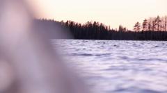 Rack focus shot of waving water movement seen through ice Stock Footage