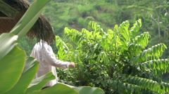 Man walk out and stretching arms enjoying morning on terrace with jungle view, 2 Stock Footage