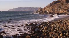 Over surf splashing against rocks on the Catalina coast. Shot in 2010. - stock footage